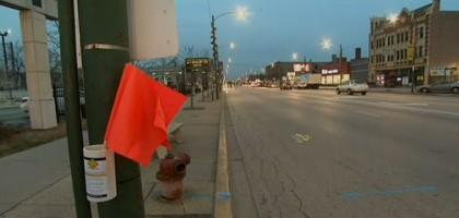 Agiter un drapeau pour traverser la route